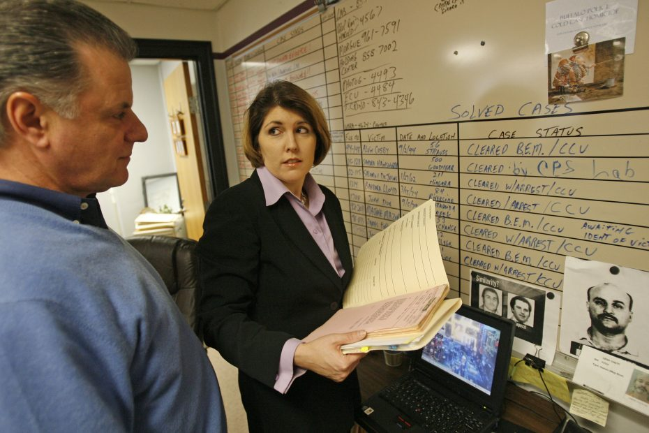 Lissa Marie Redmond, a retired Buffalo police cold case detective, now writes crime mystery novels based in Buffalo. Her first novel, 'A Cold Day in Hell,' is full of characters, places and situations roughly based on things Redmond witnessed on the job. (Sharon Cantillon/Buffalo News)