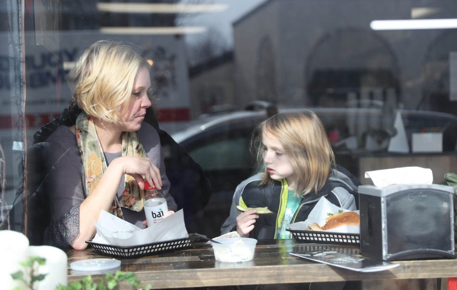 Anjanette Surma of Buffalo and her son Cooper, 9, have lunch at Main Street Deli. (Sharon Cantillon/Buffalo News)