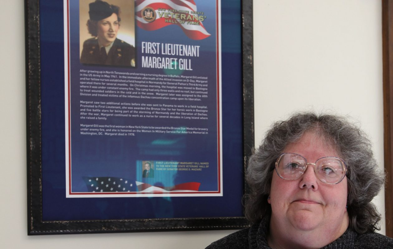 Mary Jeffords, of Sanborn, poses next to a new plaque in honor of her mother, the late Margaret Gill, a Nurse during World War II who was awarded a Bronze Star for her service, in North Tonawanda City Hall, Friday, August 19, 2011.  (Buffalo News file photo)