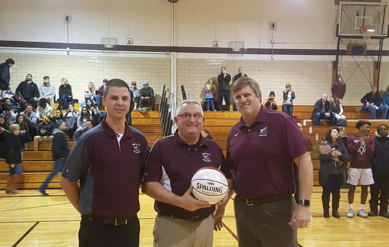 Maryvale boys basketball coach Mark Kensy receives a commemorative ball for reaching his 400th win on Feb. 2. Pictured with Kensy is JV coach Ryan Mohr, left, and athletic director Steve Griffin. (Photo provided by Steve Griffin)