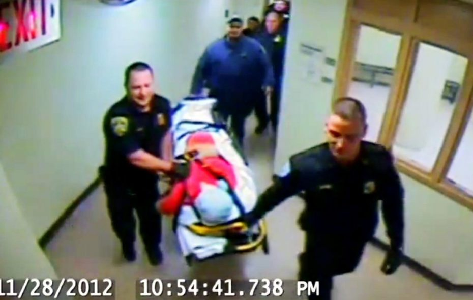 Jailhouse video shows inmate Richard A. Metcalf Jr., his head shrouded in a pillow case, being wheeled from the Erie County Holding Center. The state Commission of Correction says he took his last unassisted breaths during this procession, because a spit mask was knotted around his neck.
