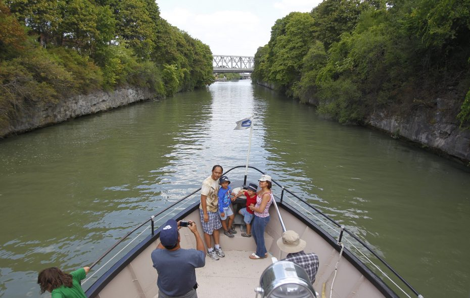 People take a boat ride on the Erie Canal and through the Lockport locks. (Mark Mulville/Buffalo News)