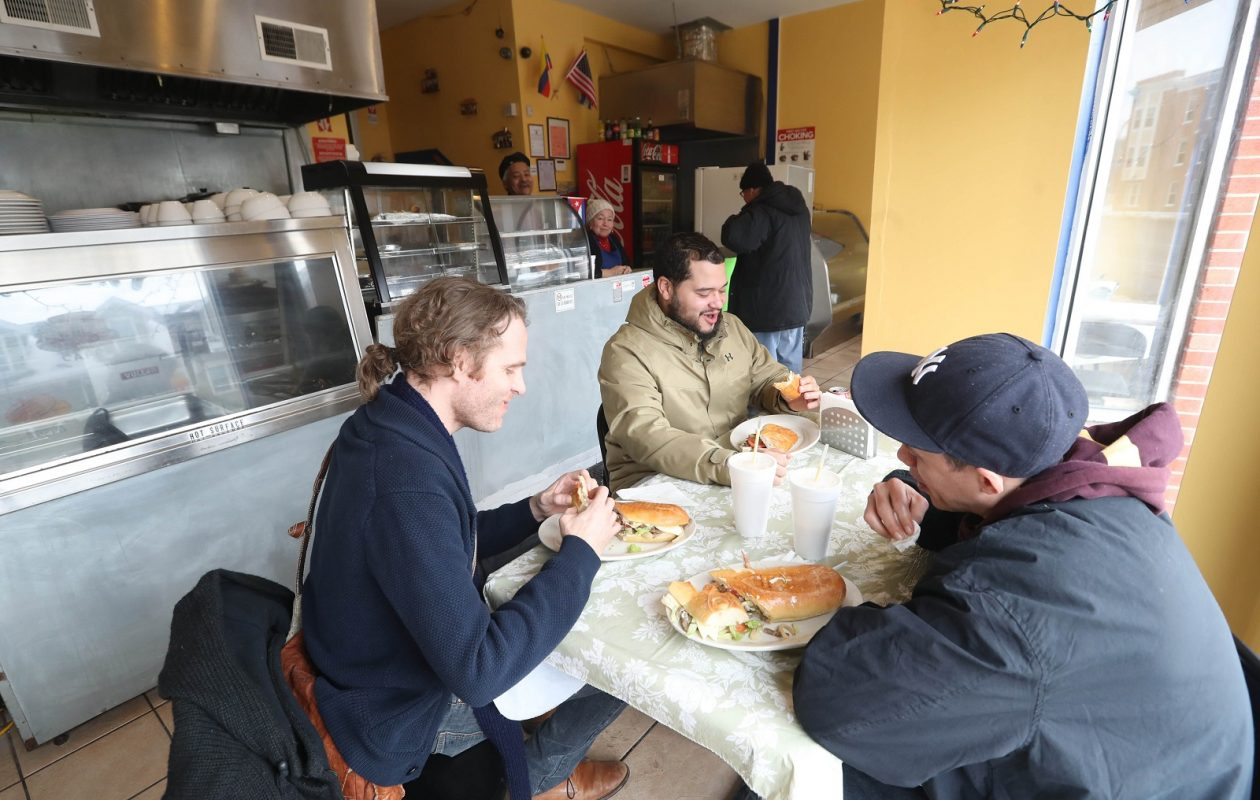 Having lunch at Sabores de mi Tierra, from left, are Jeremy Sullivan, Christian Parra and Bryan Sydenstricker, of Buffalo.  (Sharon Cantillon/Buffalo News)
