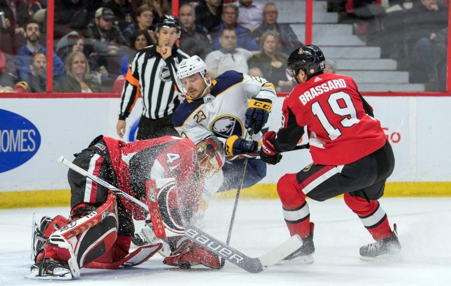 Sam Reinhart battles Ottawa's Derick Brassard for the puck in front of goalie Craig  Anderson (USA Today Sports).