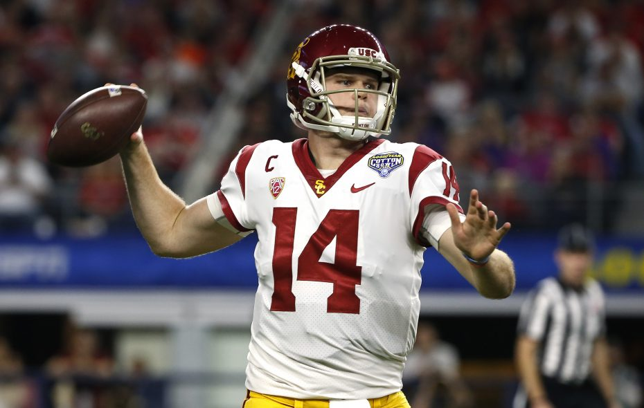 Sam Darnold of the USC Trojans looks to throw against the Ohio State Buckeyes in the first half of the 82nd Goodyear Cotton Bowl Classic between USC and Ohio State at AT&T Stadium on Dec. 29, 2017, in Arlington, Texas. (Ron Jenkins/Getty Images)