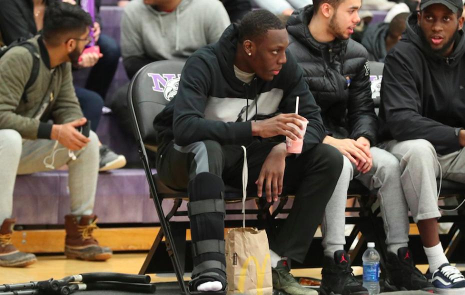 Niagara's high-scoring guard Matt Scott donned a boot and crutches at the school's women's basketball game on Tuesday, Feb. 20, 2018 (James P. McCoy/Buffalo News)