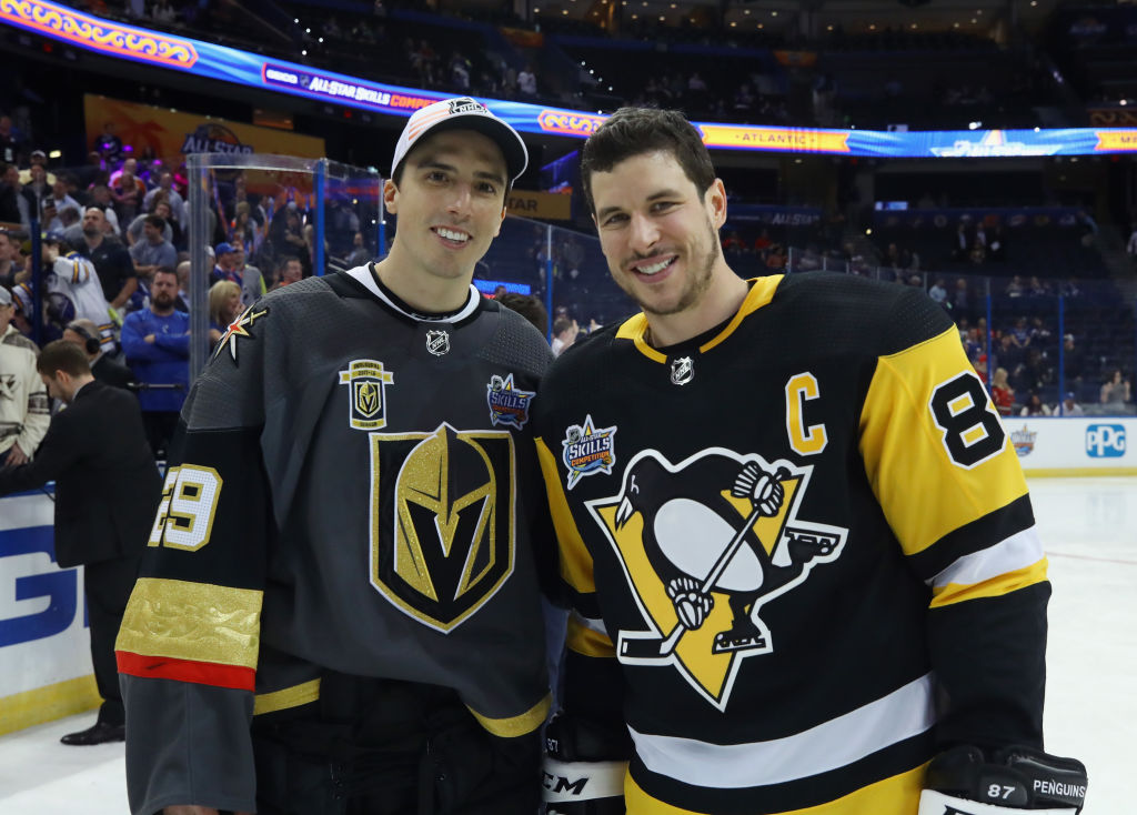 Red-hot Sidney Crosby, right, had a reunion with longtime Penguins teammate and current Vegas goalie Marc-Andre Fleury at the All-Star Game. They will meet for real Tuesday night in Pittsburgh. (Getty Images).