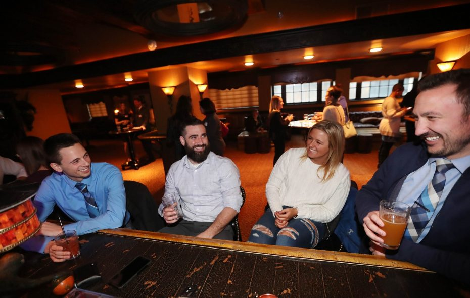 Coworkers have a drink in the Lobby Bar after work. From left is Bryan Minicucci, Ryan Marcey, Brittney Michael and Chris Mascia. (Sharon Cantillon/Buffalo News)