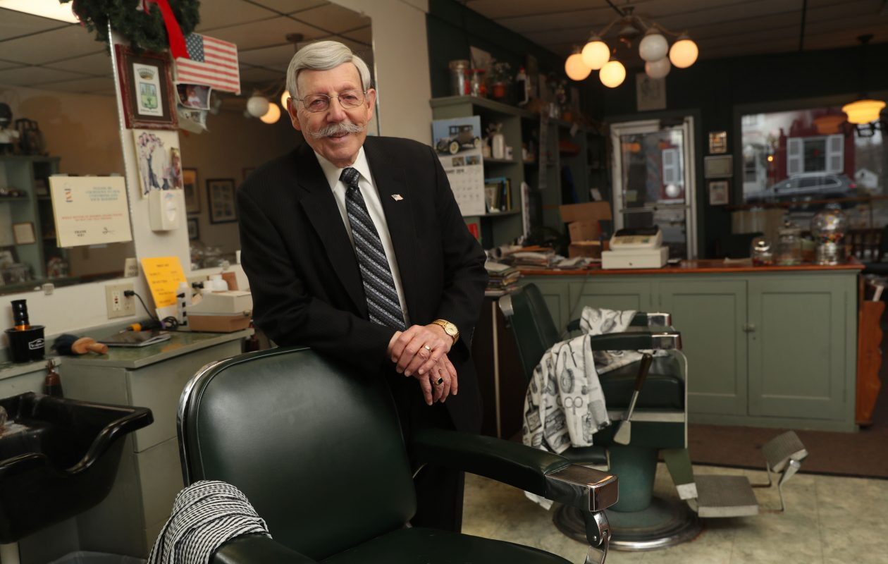 Lewiston Mayor Terry Collesano stands in his Olde Time Barber Shop on Center Street in Lewiston on Monday, Feb. 19, 2018, after he announced he won't seek re-election and is retiring from public service. Collesano has been a barber in the village for 61 years.  (Sharon Cantillon/Buffalo News)