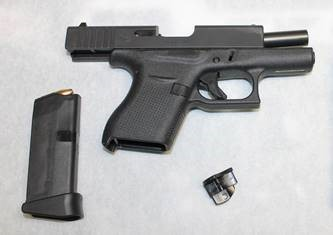 Transportation Security Administration officers said they found this loaded 9 mm handgun in an Erie, Pa. woman's carry-on bag while they were screening luggage at the Buffalo Niagara International Airport on Wednesday, Feb. 21. (Provided by the Transportation Security Administration)