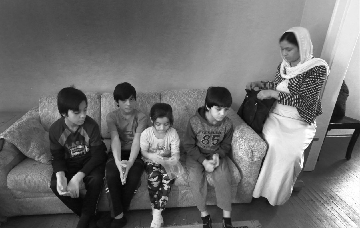 Mahya Algasim, 37, organizes her children's identification cards in the family's living room in Buffalo. They are, from left, Fadhil, 12, Fadi, 13, Fadya, 7, and Foad, 10. (Robert Kirkham/News file photo)