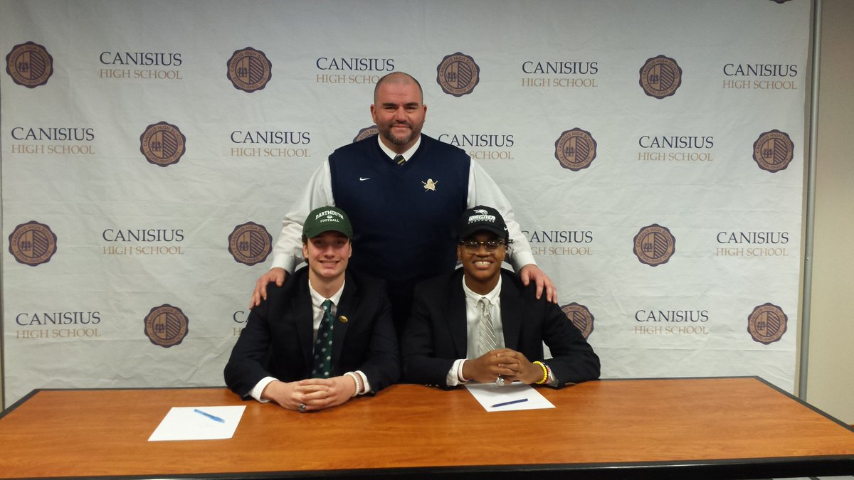 Canisius coach Rich Robbins, receiver  RJ Brandon and quarterback Jayce Johnson are all smiles during the National Signing Day event at Canisius High School Wednesday.
