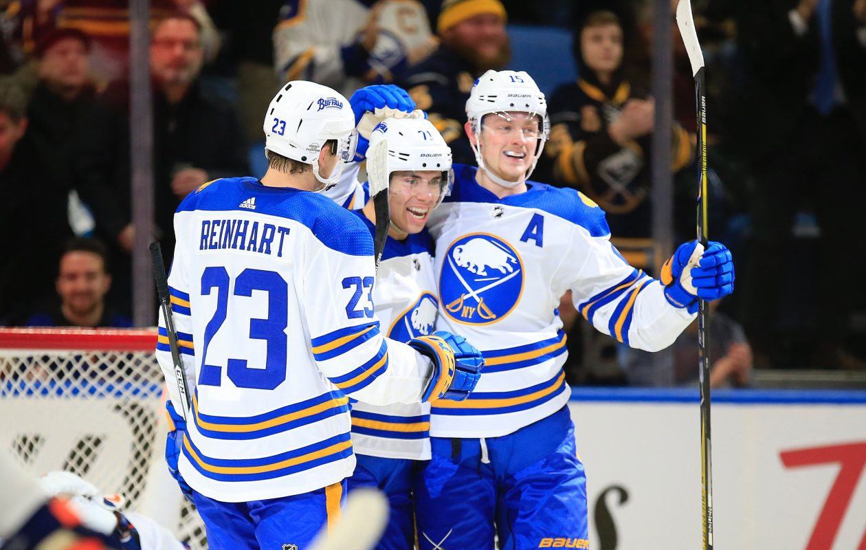 Evan Rodrigues, center, celebrates a goal with Sam Reinhart and Jack Eichel. (Harry Scull Jr./News file photo)