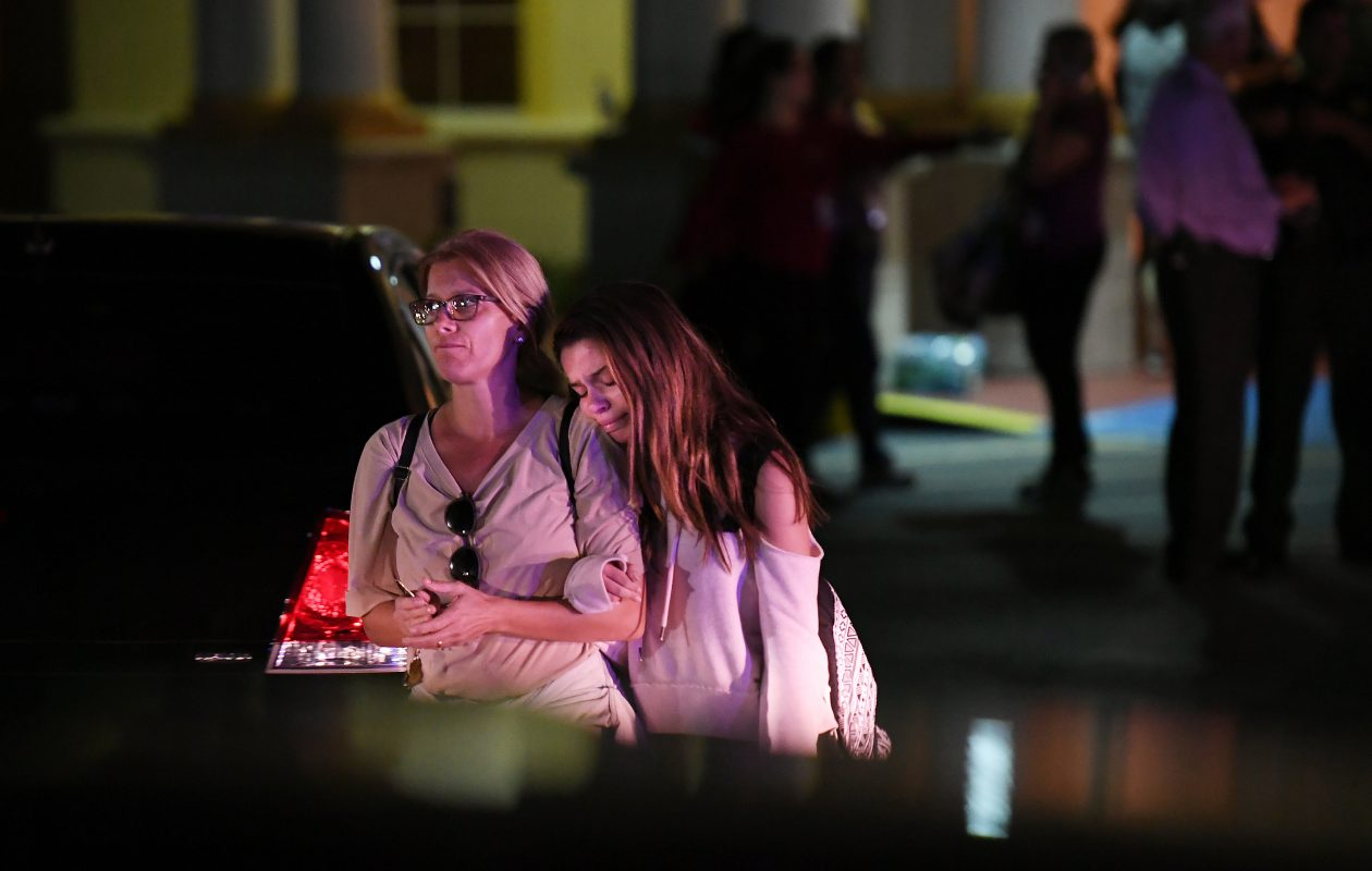Reunited relatives leave the Marriott Coral Springs Hotel on Wednesday night following a deadly shooting at Marjory Stoneman Douglas High School. (Washington Post photo by Matt McClain)