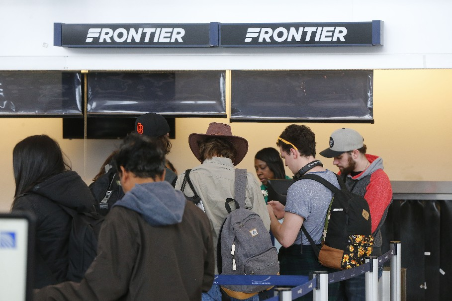 Travelers crowd the ticket counter at Frontier Airlines, whose arrival helped drive a 7.5 percent increase in passengers using Buffalo Niagara International Airport. (Mark Mulville/Buffalo News)