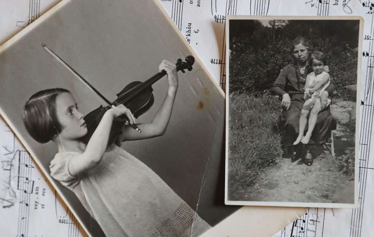 At left, Britta Hausmann plays the violin as a young girl. At right, she sits on the lap of her grandmother, Toni Marcus, who later died at Auschwitz. (Sharon Cantillon/Buffalo News)