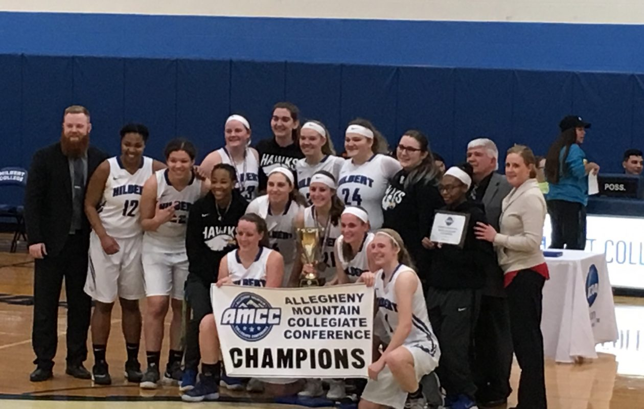 The Hilbert women's basketball team celebrates winning the conference tournament (Provided photo)