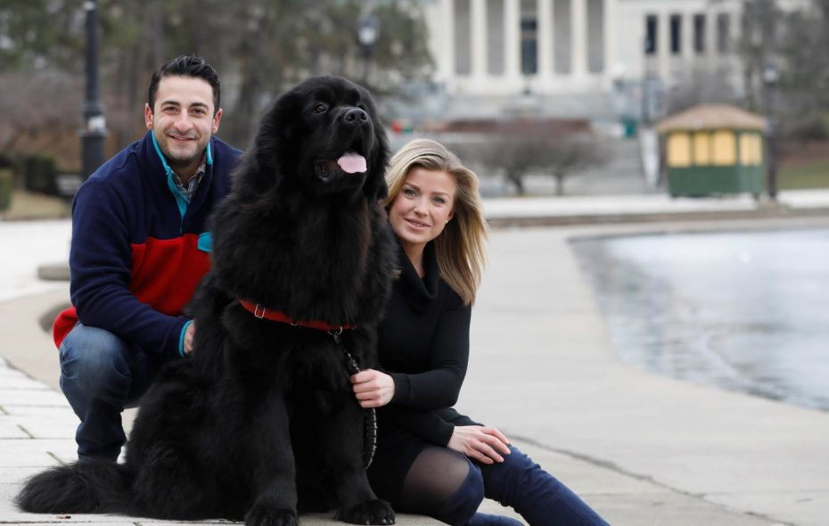 "Jonah Javad and Nalino Shapiro with their dog Bogey, whom Javad says is ""their 160-pound engagement ring."" (Derek Gee/Buffalo News)"