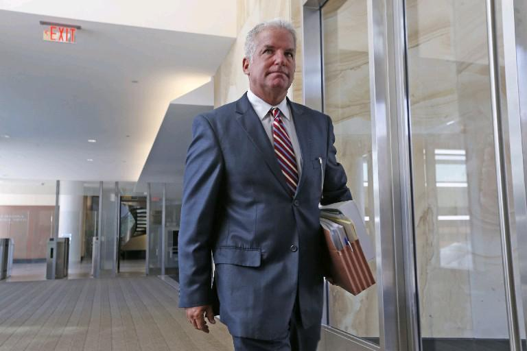 U.S. Attorney James P. Kennedy praises staffers for his office's ability to recover $17.9 million by going after fraud and other crimes.  (Robert Kirkham/Buffalo News file photo)