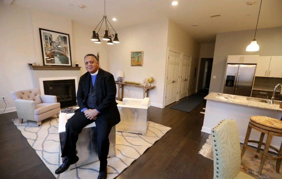 The Rev. Paul Will H. Mebane shows off one of the apartments in his church's new Cathedral Commons on Pearl Street downtown. (Mark Mulville/Buffalo News)