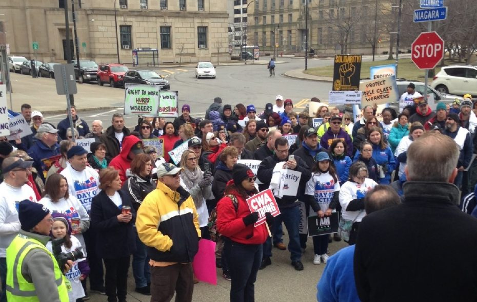 More than 200 people attended the Working Families Party rally in front of the U.S. District Courthouse downtown Saturday. (Phil Fairbanks/Buffalo News)