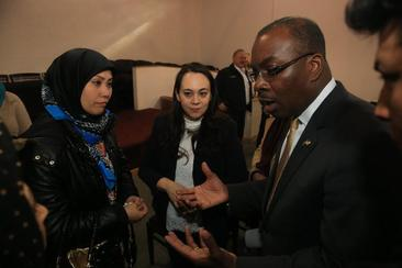 Buffalo Mayor Byron W. Brown speaks with Robobeh Ohorbanzedah, left, an Afghan refugee, last year. Refugees have bolstered Buffalo's population, but the Trump administration has reduced the numbers allowed into the country. (John Hickey/Buffalo News)