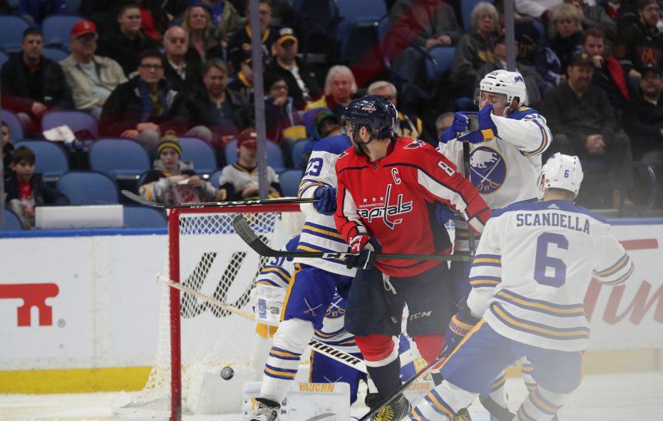 Washington's Alex Ovechkin tips home Monday's opening goal, giving him 35 for the season. (James P. McCoy/Buffalo News)