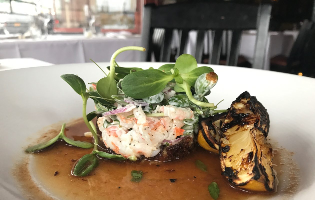 Cold shrimp and crab salad with charred tomato-citrus broth and Vertical Fresh Farms sunflower microgreens was a recent menu feature at Bacchus Wine Bar & Restaurant. (Caitlin Hartney/Special to The News)
