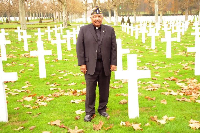 The Rev. Eugene Pierce at the grave of Cpl. Jesse W. Clipper,  the first black soldier from Buffalo to die in World War I, in the Oise-Aisne American Cemetery and Memorial in Seringes-et-Nesles, France. (Courtesy of Rev. Eugene Pierce)