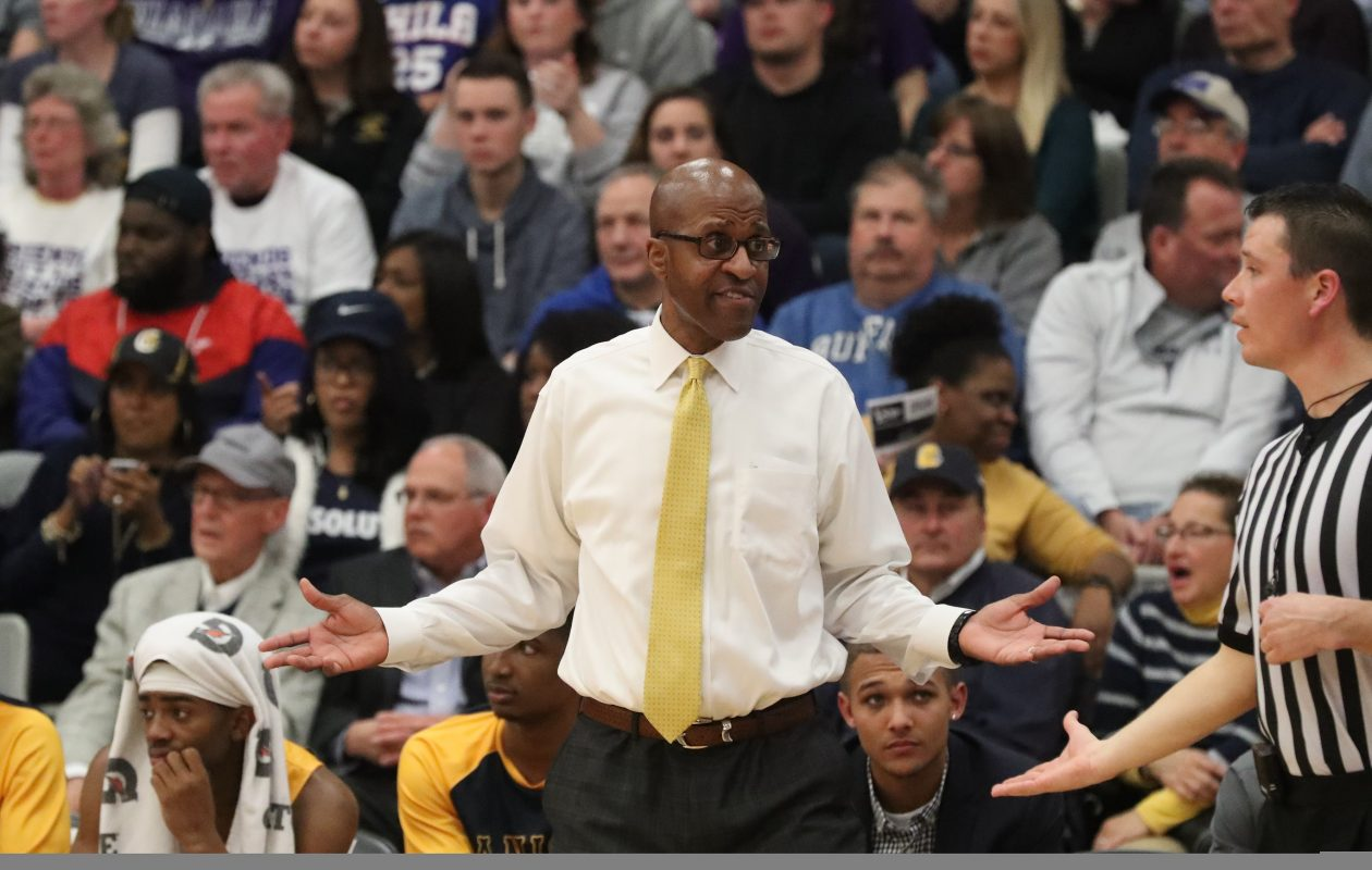 Canisius Golden Griffins head coach Reggie Witherspoon talks to the ref about a call in the first half in the Gallagher Center at Niagara University in Lewiston NY on Wednesday, Feb. 21, 2018.  (James P. McCoy / Buffalo News)