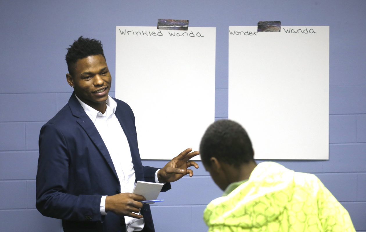 In his role as a youth mentor, Anthony Donalson teaches an anti-bullying lesson to kids in a youth group using a classroom at St. Mary's School for the Deaf. (Robert Kirkham/Buffalo News)