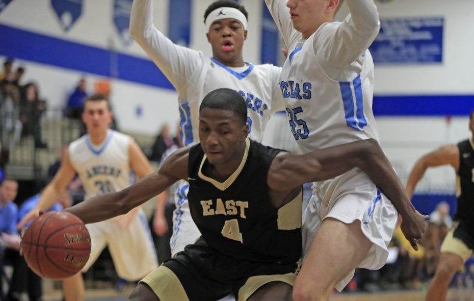 East's Justin Allen, shown here against St. Mary's, recorded 27 points and 20 rebounds in the Panthers' state quarterfinal win over Clyde-Savannah last Saturday. (Harry Scull Jr./ Buffalo News)