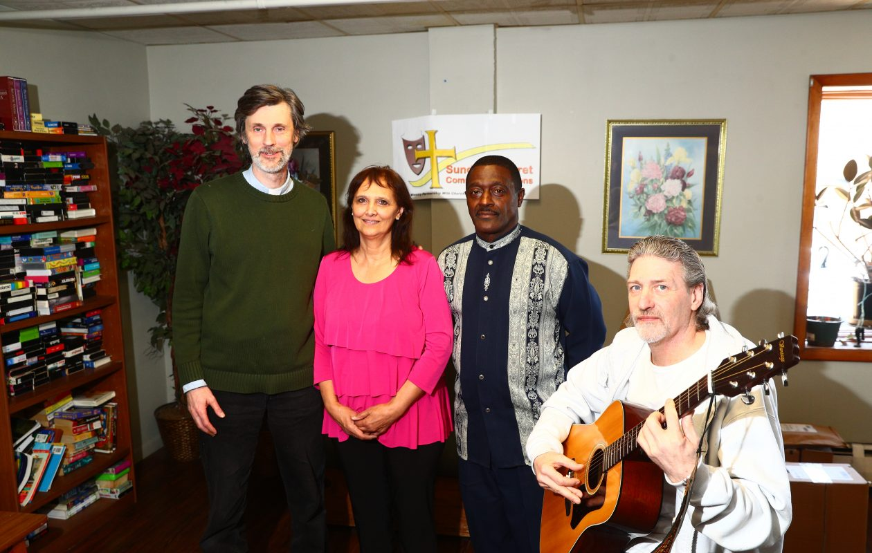 Four people who had a hand in the recent 'Sunday Cabaret' at Community Missions of the Niagara Frontier in Niagara Falls are, from left, the Rev. Mark Breese, agency minister, who organizes the events; singer Ronald Harrison of Niagara Falls; Joanne Lorenzo of the Magdalene Project, who played keyboards; and Chuck Hawk, an audience member who got up and blew the crowd away with a couple of tunes on the guitar.  (John Hickey/Buffalo News)
