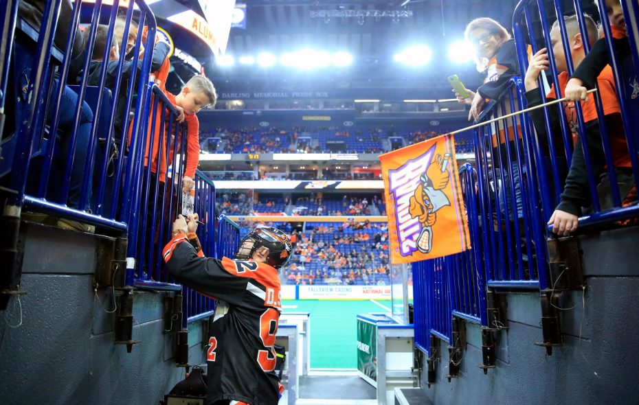 Buffalo Bandits Dhane Smith signs autographs prior to playing the Rochester Knighthawks during at the KeyBank Center on Saturday, Feb. 24, 2018. (Harry Scull Jr./Buffalo News)