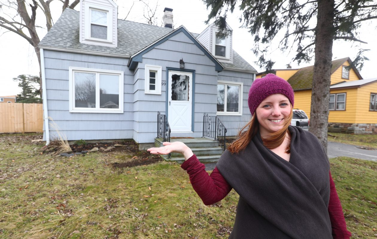 Vanessa Krnjaich, 26, put a lot of sweat equity into the long-vacant home she bought on Rose Avenue in West Seneca for $45,555 at auction. 'It needed a lot of love,' she says. (John Hickey/Buffalo News)