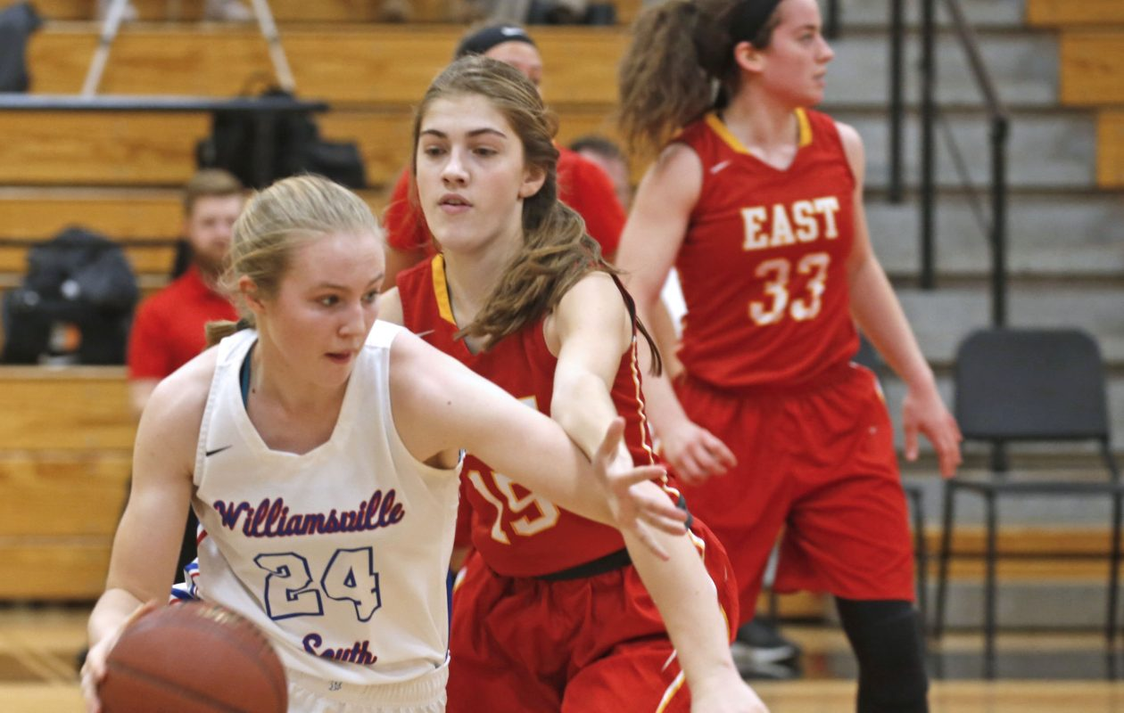 South Tatyjana Scalisi charges for the basket around East's Chelsea McNamara during action at the Class A-1 semifinal battle of the Williamsvilles at Clarence High School.  (Robert Kirkham/Buffalo News)