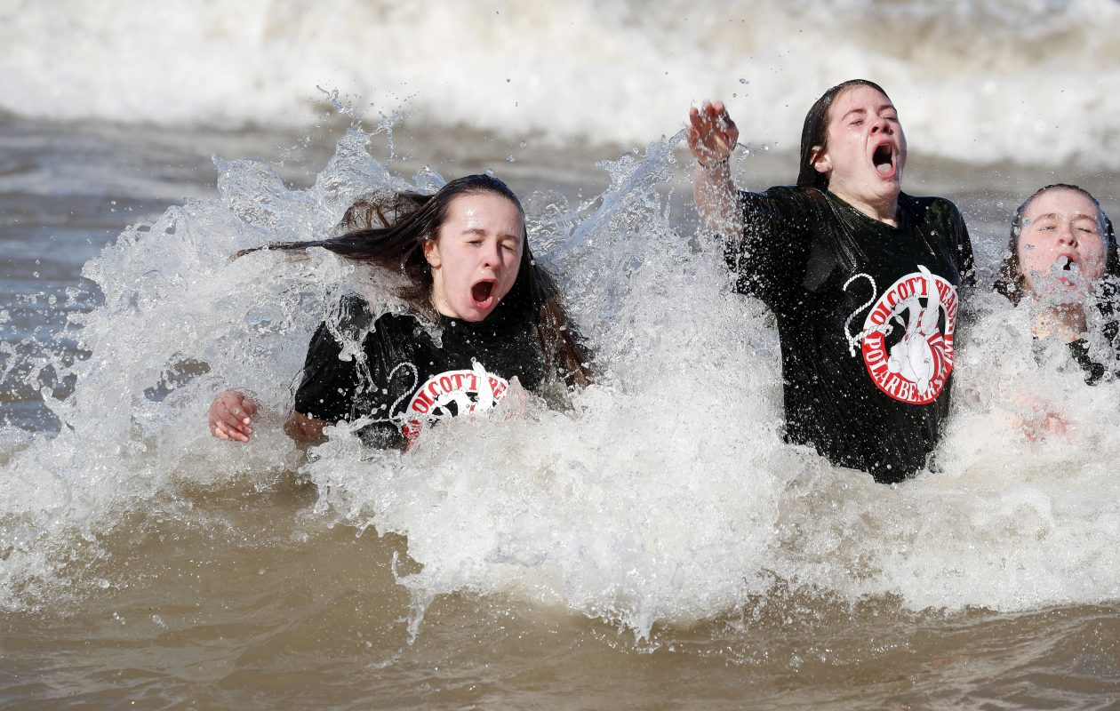 People took to the frigid waters of Lake Ontario on Sunday for the 49th Annual Polar Bear Swim For Sight, sponsored by the Olcott Lions Club, at Olcott Beach. (Mark Mulville/Buffalo News)