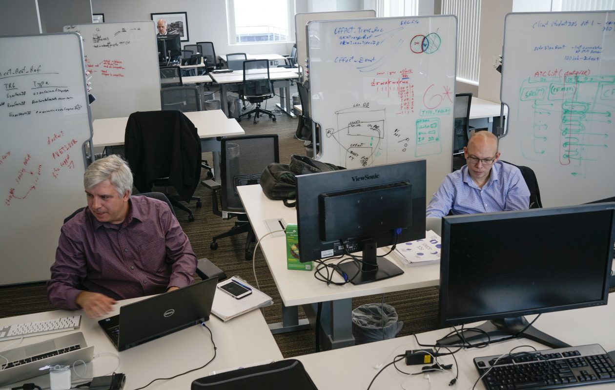 Rob Myers, lead architect, left, and IT Specialist Jesse Ure, right, work in the flexible workspace in the IBM Buffalo Innovation Center.  (Derek Gee/Buffalo News)