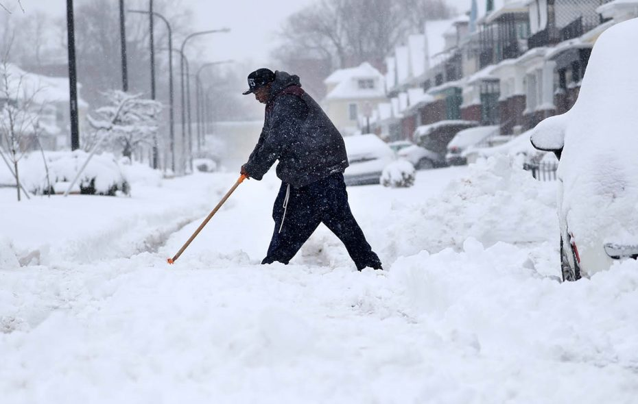 Jerell Goree of Beverly Road on Buffalo's East Side almost got stuck trying to get out of his driveway, so he has to shovel the street so he can get out.	Sharon Cantillon/Buffalo News