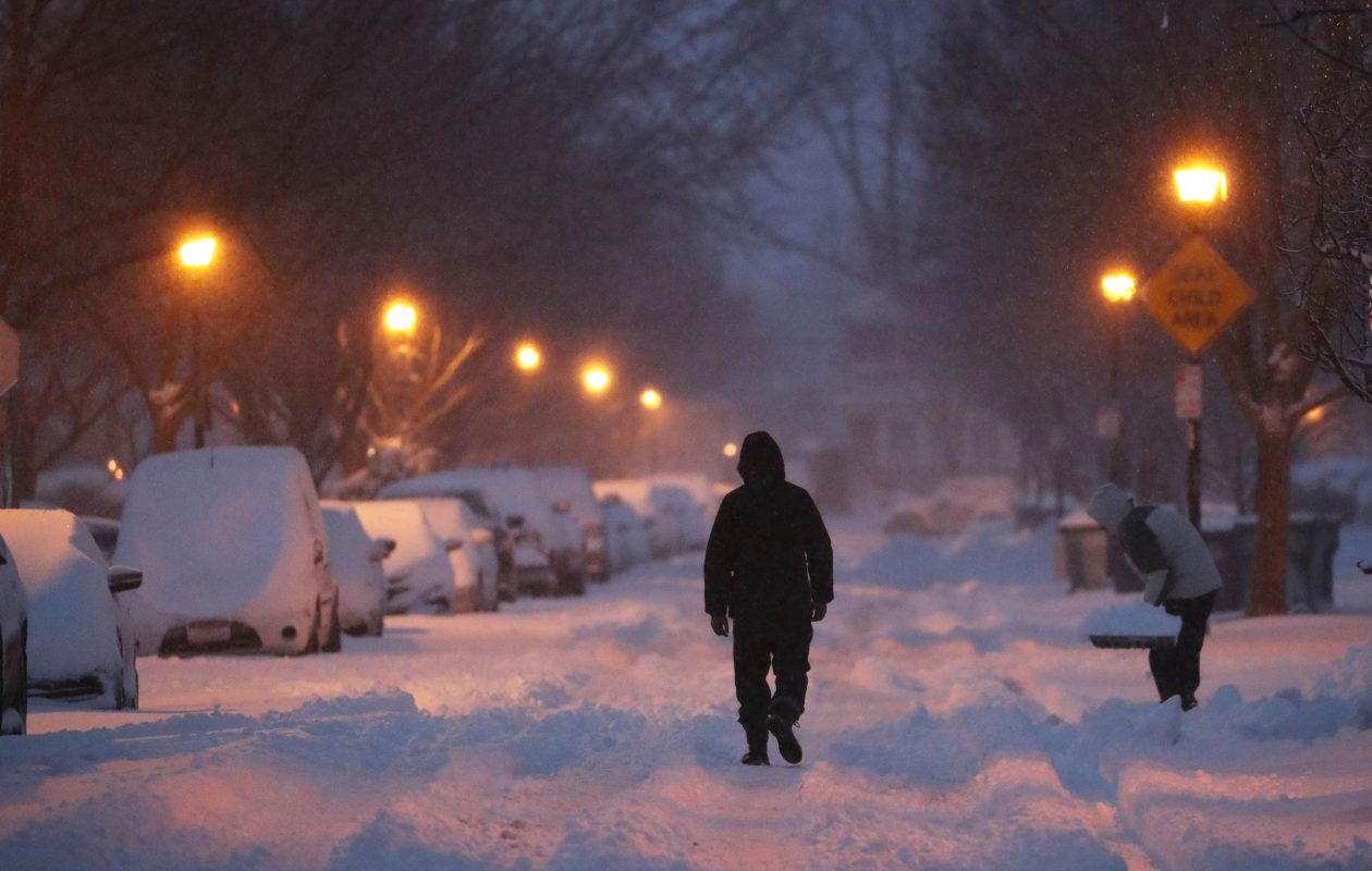 Buffalo area residents woke up to more than six inches of heavy snow on, Friday, March 2, 2018.  A pedestrian walks down the middle of North Park Avenue in North Buffalo in the morning hours. (Sharon Cantillon/Buffalo News)