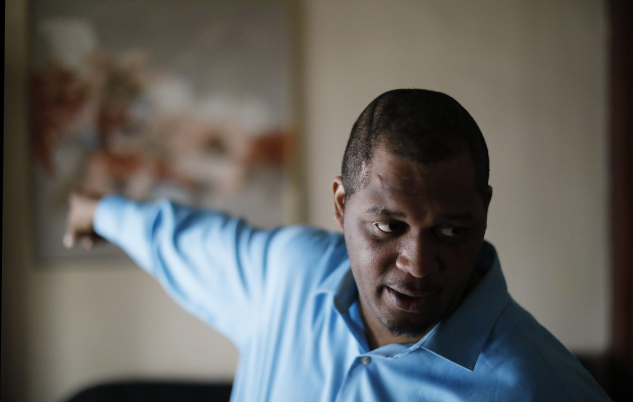 Randy D. White, who was shot by a parole officer Feb. 27 as he was dropping off a friend at home, recounts his experience during an interview in his South Buffalo home on Tuesday, March 6, 2018. (Derek Gee/Buffalo News)