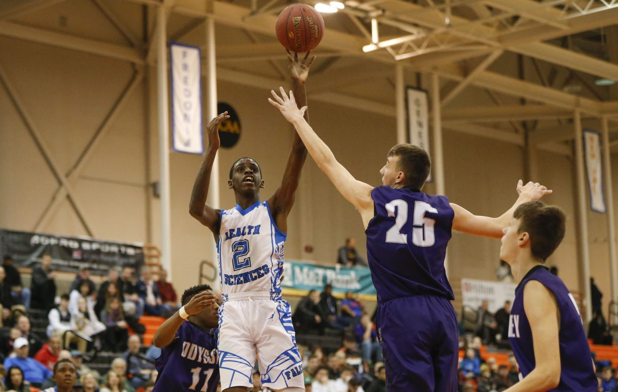 Health Sciences' Davonte Gaines shoots over Greece Odyssey's DJ Billings (25) during Saturday's Class B Far West Regional contest at Buffalo State Sports Arena. (Derek Gee/Buffalo News)