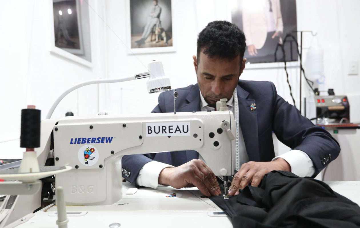 Abbas Abbas is an Iraqi immigrant from Syria who was hired as a tailor in the upscale meanswear store Bureau on Elmwood Avenue in Buffalo.   (Sharon Cantillon/Buffalo News)