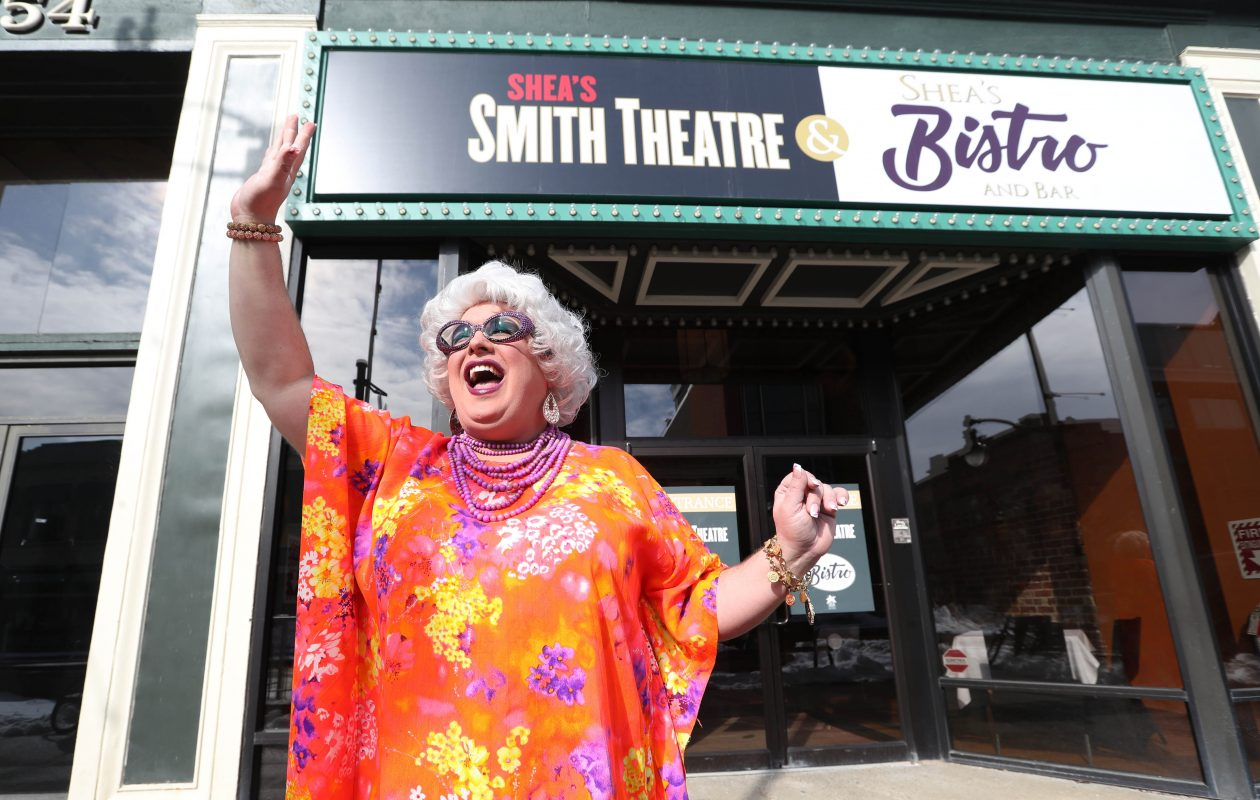 Betsy Carmichael, a character created by Buffalo performer Joey Bucheker, waves to passers-by in front of Shea's Smith Theatre, where 'Betsy Carmichael's Bingo Palace' runs March 23 to 25. (Sharon Cantillon/Buffalo News)