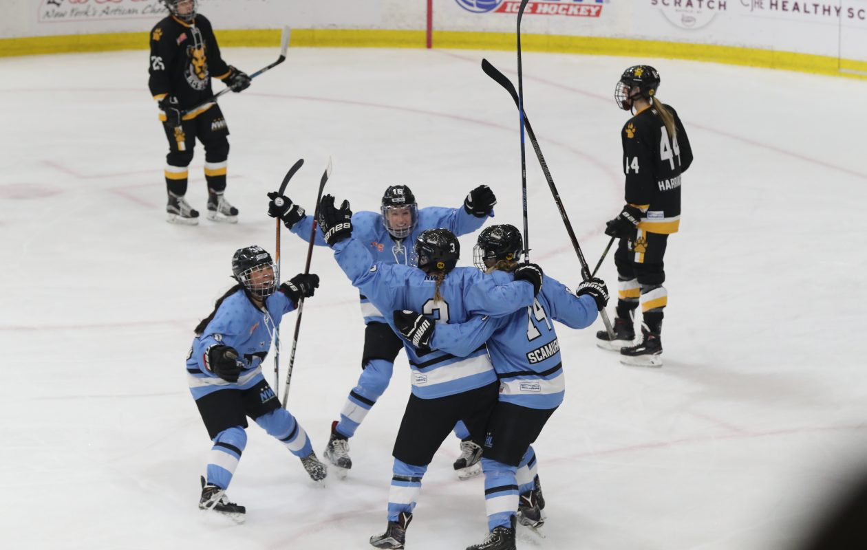 Buffalo Beauts' Sarah Edney scores a goal on Boston Pride's Brittany Ott during the first period in the playoff semifinal at HarborCenter in Buffalo on Saturday, March 17, 2018. (James P. McCoy/Buffalo News)