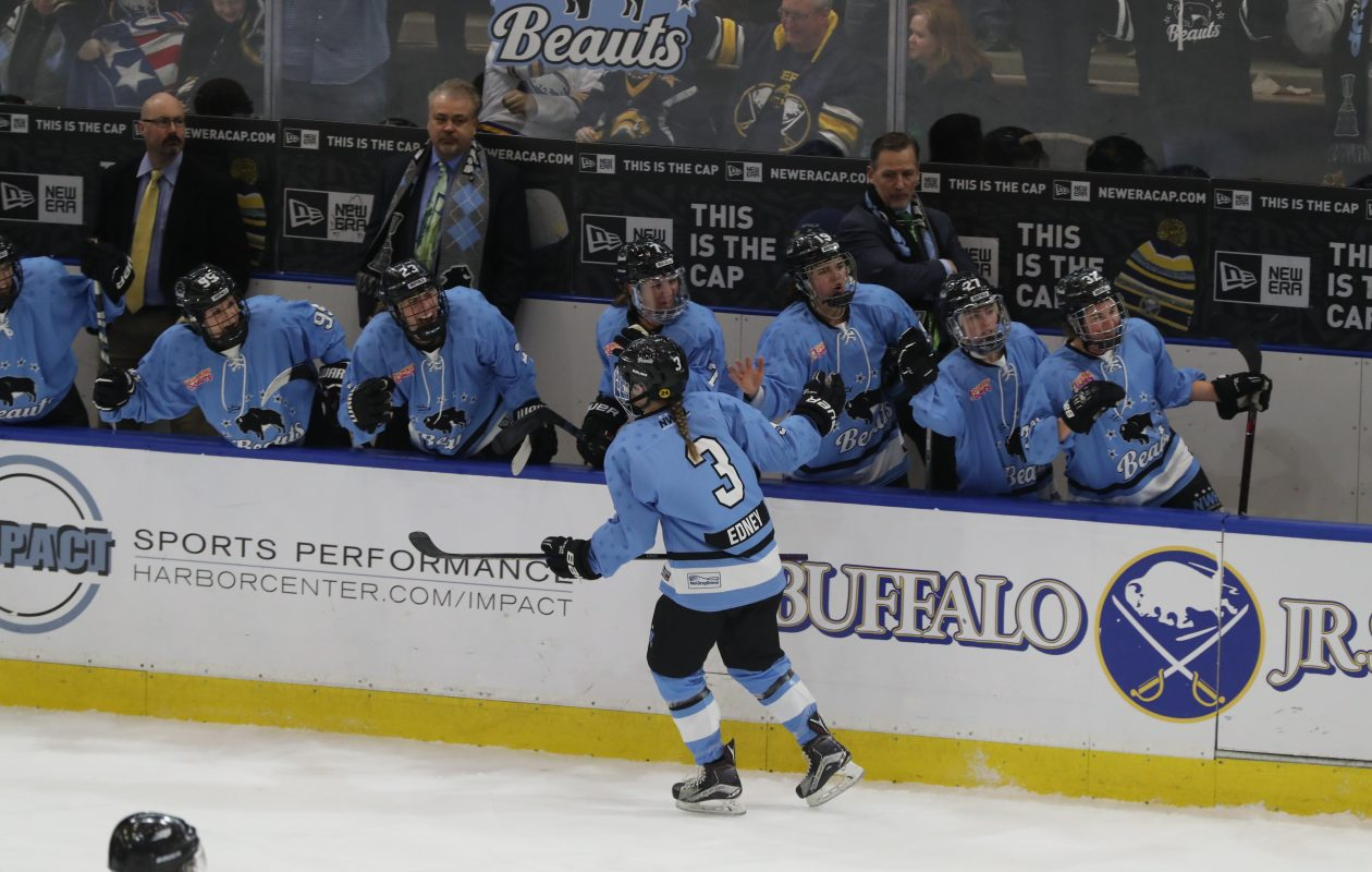 Buffalo Beauts Sarah Edney scores a goal on Boston Pride's Brittany Ott during the first  period in the playoff semifinal at HarborCenter in Buffalo,NY on Saturday, March 17, 2018.  (James P. McCoy / Buffalo News)