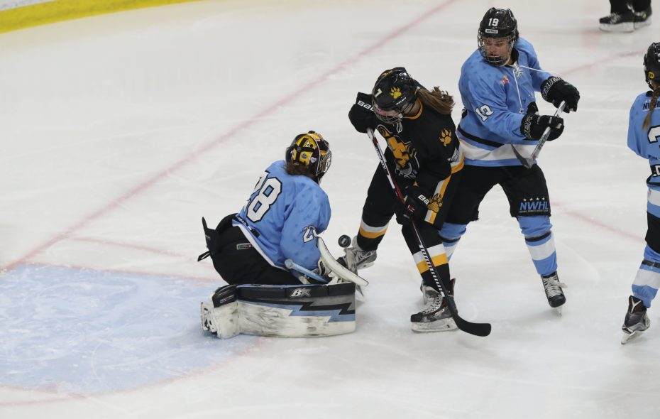Buffalo Beauts Amanda Leveille stops a shot from Boston Pride's Elizabeth Parker in the first  period in the playoff semifinal at HarborCenter in Buffalo,NY on Saturday, March 17, 2018.  (James P. McCoy / Buffalo News)