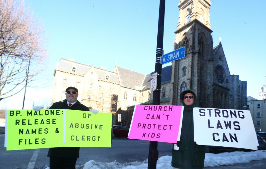 Robert Hoatson, right,  from Road to Recovery Inc., and James Faluszczak protest the bishop and the diocese to release names of sexually abusive priests on March 18, 2018. (John Hickey/Buffalo News)