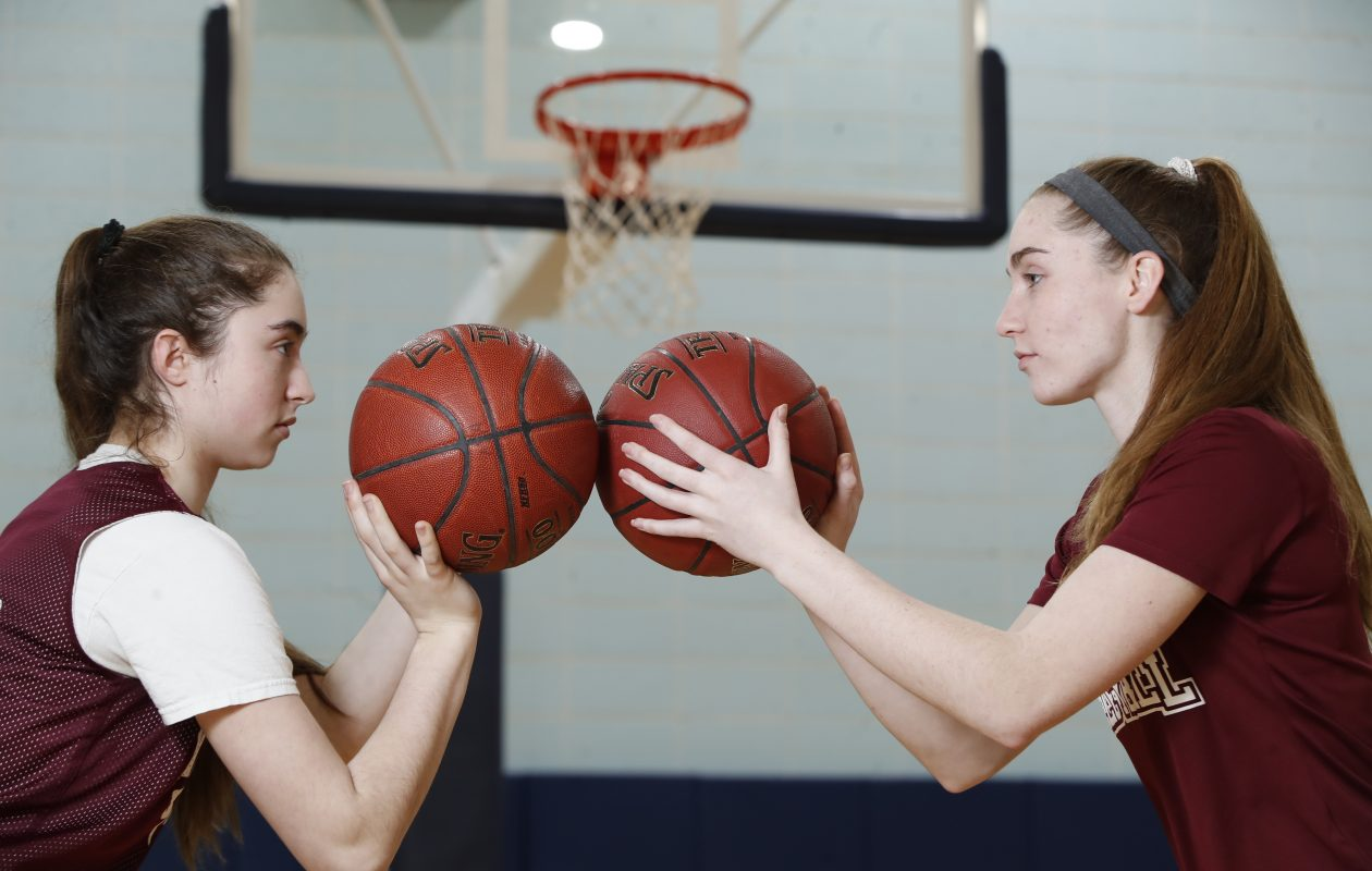 Sophomore Siobhan Ryan and senior Micaela Ryan have been known to  play each other rather competitively in practices, but they're both driven to help the Sharks succeed on game day. (Harry Scull Jr./ Buffalo News)