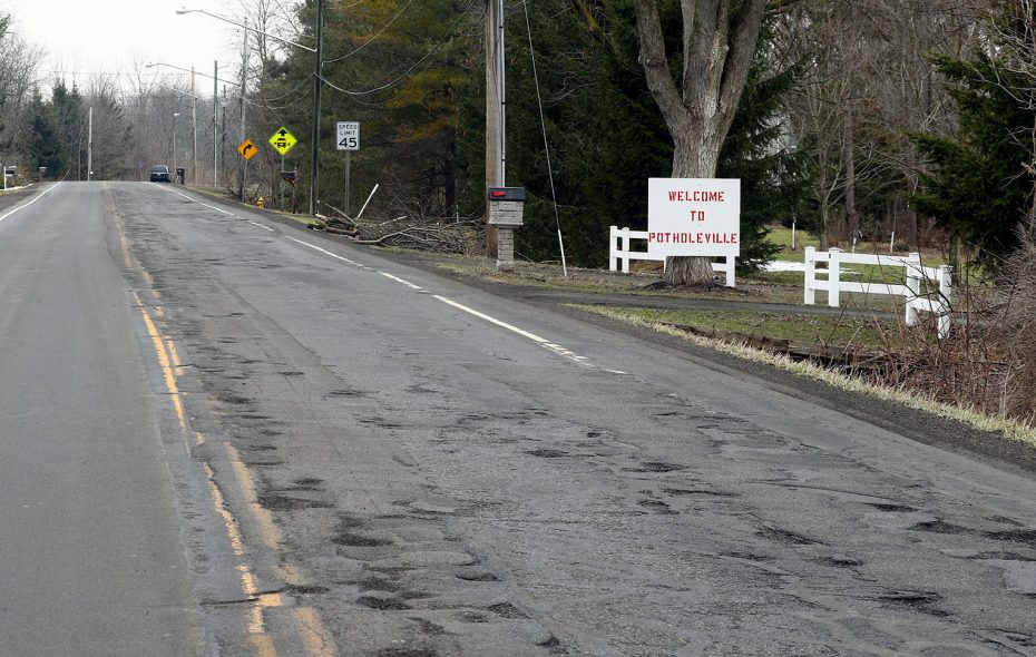 Cracks that were just bumps in the road a few weeks ago have opened into craters on city streets, county highways and state byways. (John Hickey/Buffalo News)